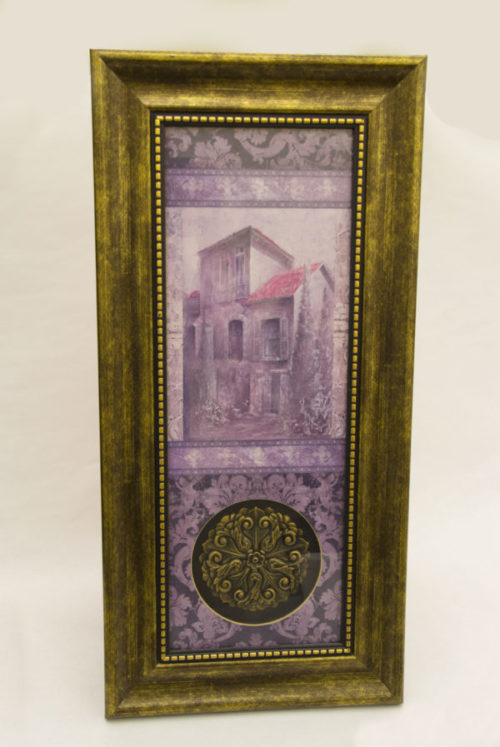 Framed painting in purple hues with a golden frame and matching floral inset device